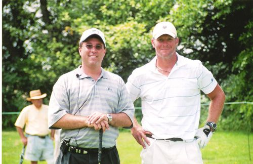 Jason Abraham pictured with Brett Farve on the golf course
