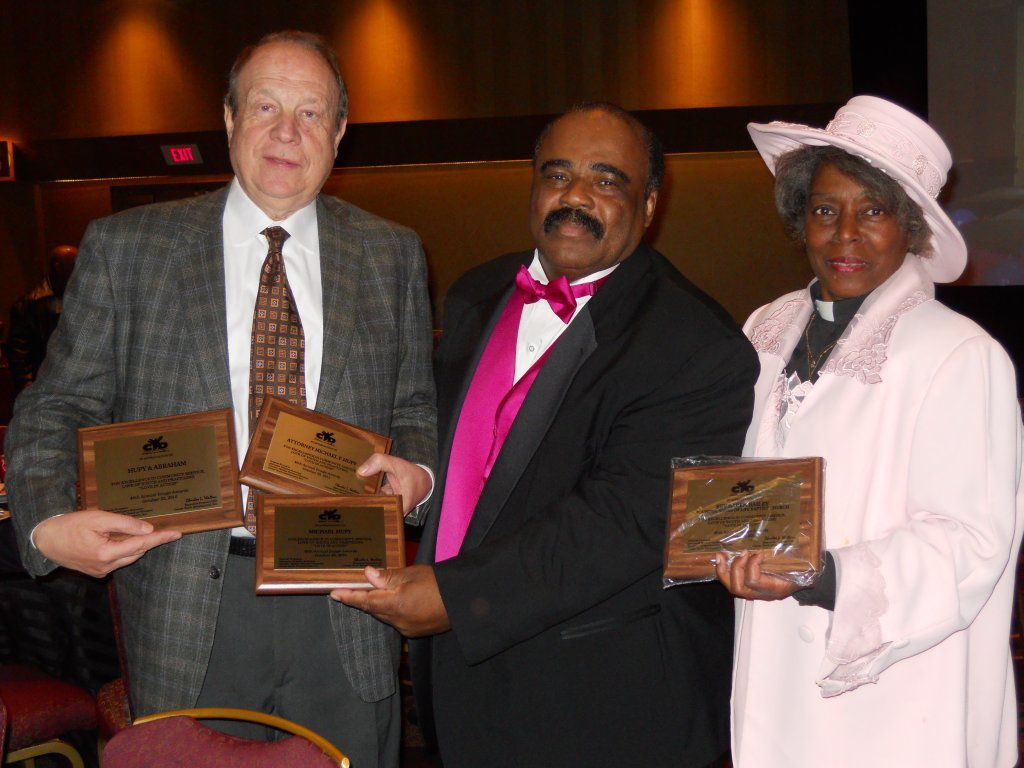 Attorney Micheal F. Hupy accepting community service awards