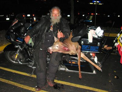 Dave Zien with Deer he hit with motorcycle while riding at night