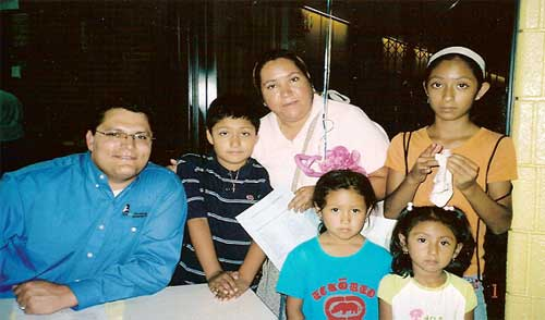 Attorney Chad Kreblin, and Veronica Zendajas surrounded by her four children